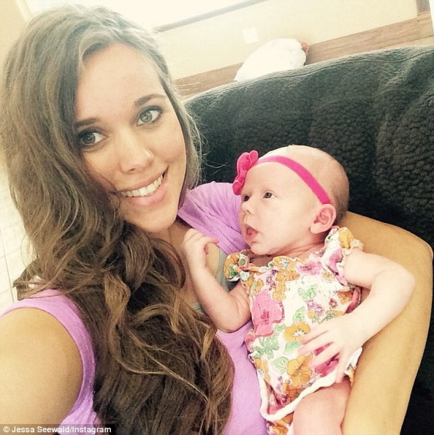 Happy: Jessa Seewald posted an image of herself holding her disgraced brother Josh Duggar's newborn daughter on Tuesday