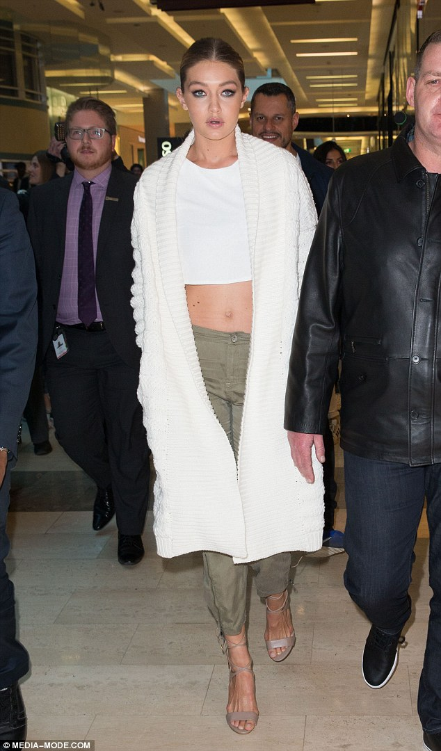 Cream of the crop! Gigi Hadid wore another midriff-baring top as she made an appearance at theGuess store at Westfield in Bondi Junction on Wednesday