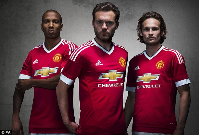 (L-R) Ashley Young, Juan Mata and Danny Blind model the new strips after a world-record £750m deal
