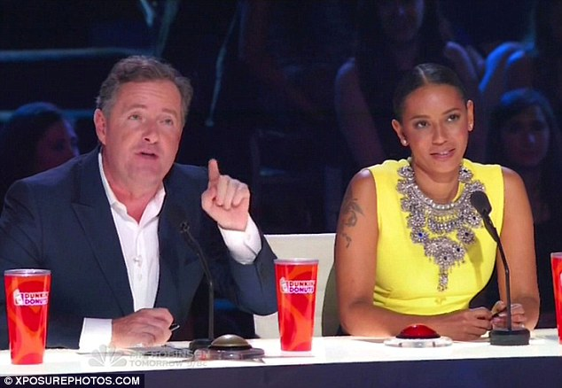 What a gent: Piers came to fellow judge Mel's rescue when an angry contestant dissed her singing voice