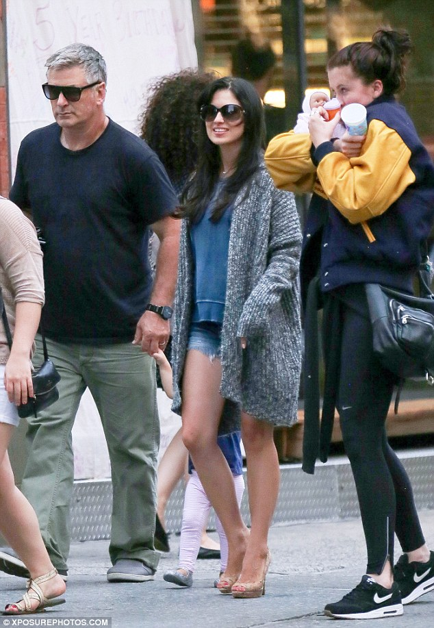 Family first: The star strolled through New York City with her husband Alec Baldwin, their daughter Carmen, nearly two, and Alec's 19-year-old daughter Ireland Baldwin in late July