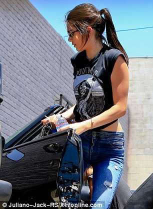 Making a statement: The model sported a funky black T-shirt that referenced the park Point Dume, Malibu