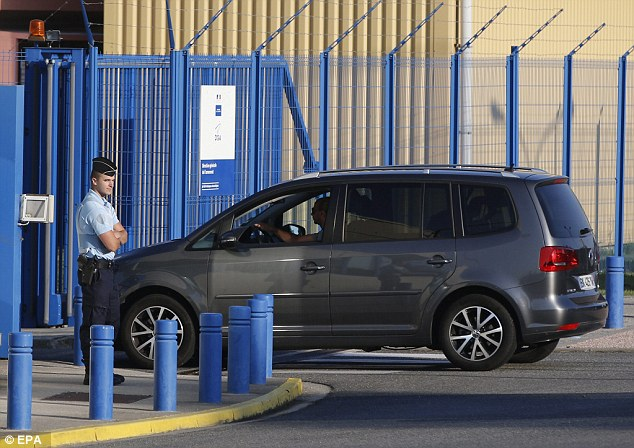 A policeman stands guard at the entrance of the facility, where French, Malaysian and Australian officials were present