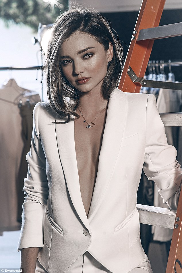 So long: The 32-year-old ditched her bra as she dressed in a plain white suit jacket for a snap