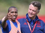 MANCHESTER, ENGLAND - AUGUST 05:  (EXCLUSIVE COVERAGE) Manager Louis van Gaal and Ashley Young of Manchester United in action during a first team training session at Aon Training Complex on August 5, 2015 in Manchester, England.  (Photo by John Peters/Man Utd via Getty Images)