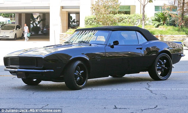 So much for getting in fresh air! Kendall was seen driving the sleek muscle car, which had its roof down