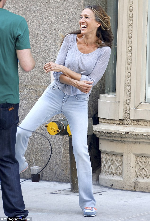 Giggle fit:Sarah Jessica Parker couldn't contain her laughter when she was spotted filming a comedy game show in New York City on Tuesday