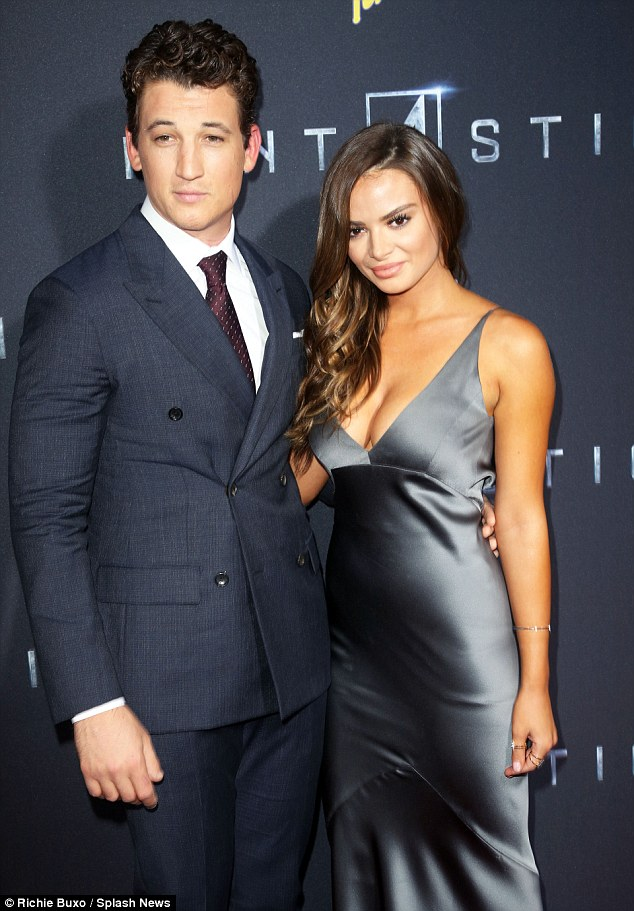 Coordinating: Keleigh donned a striking silver dress, while Miles sported a sharp grey suit