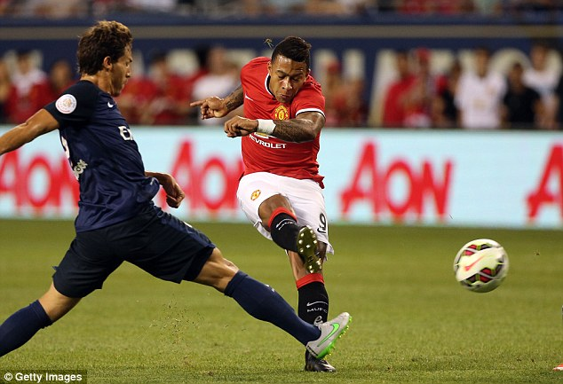 Dennis Irwin has backed Memphis Depay (right) to take over from Beckham with his dead ball ability