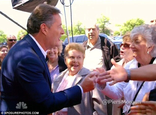 Meet and greet: Piers shook hands with an eager fan as he arrived ahead of the live shows