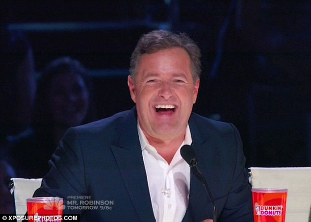 Loving it: The 50-year-old presenter was in charge of the special golden buzzer