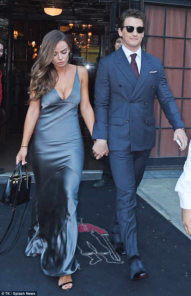 Glamorous exit: Miles and Keleigh turned heads as they left their hotel
