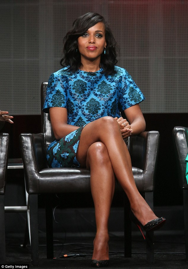 Poised! Washington elegantly crossed her legs as she took a seat at the panel