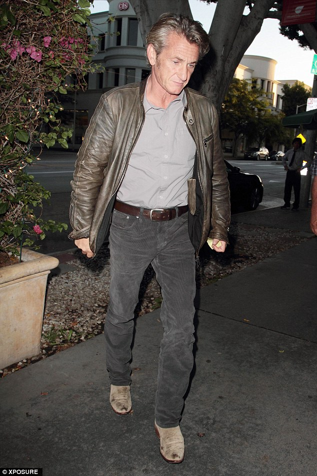 Somber figure: Sean Penn appeared far from happy as he headed to dinner in Beverly Hills, California, on Tuesday evening