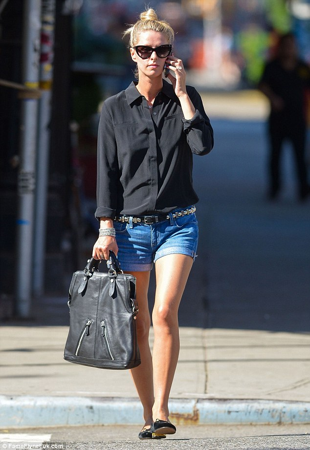 Perfect pins:Newlywed Nicky Hilton displayed her lean legs in a pair of denim shorts while out and about in New York City on Tuesday as she continued to adjust to life as a married woman