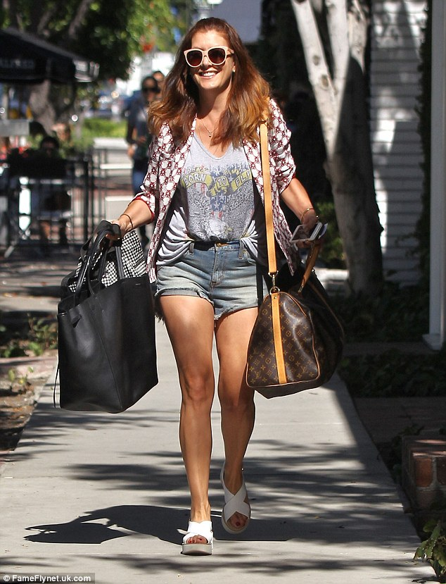 Smiling in the sun: Kate Walshshowed off her youthful physique and incredible legs as she shopped on Melrose Place in Los Angeles on Tuesday
