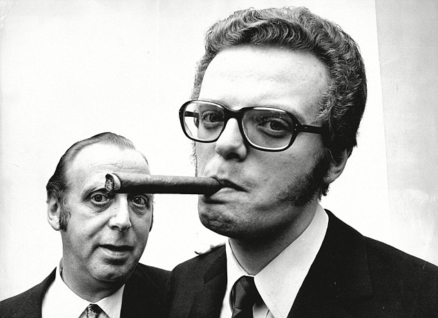 Known for smoking cigars: TV executive Michael Grade in 1969 with his father, theatrical agent Leslie Grade
