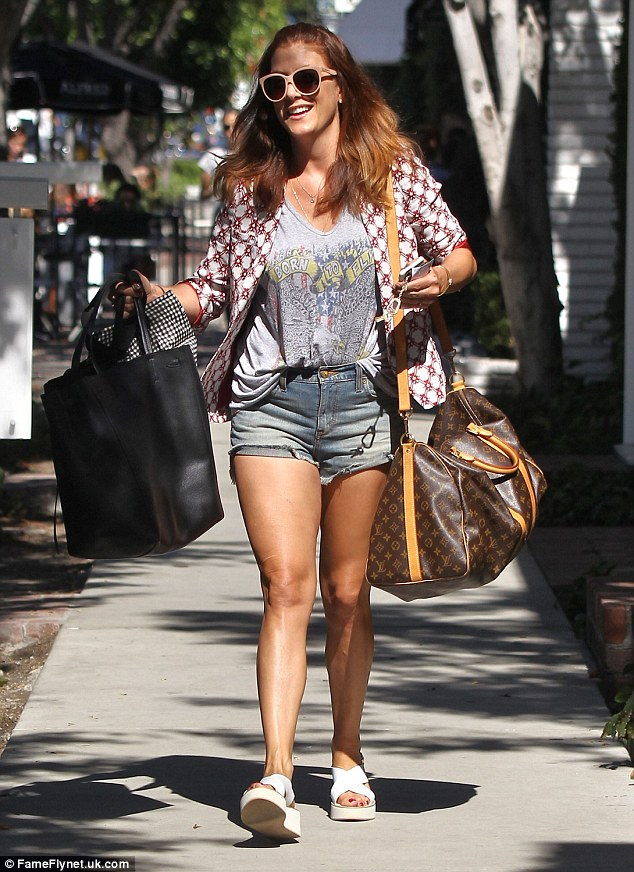 LA life: The former Grey's Anatomy starcouldn't keep the smile off her face as she enjoyed the sun during her midday trip to the shops