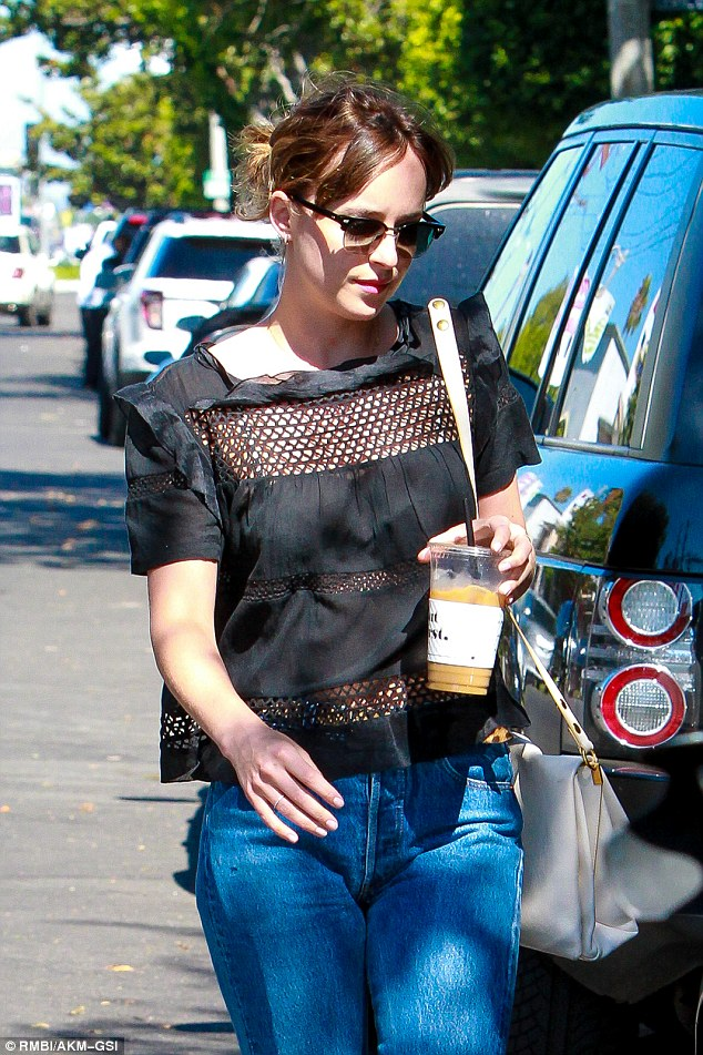 Shady lady: The 25-year-old put on a casual sartorial display as she donned a black blouse and boyfriend jeans