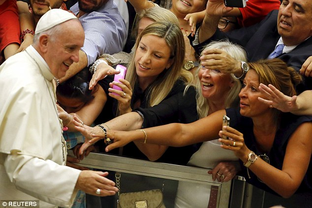 Popular: Francis addressed hundreds of pilgrims and tourists at his first general audience since the summer break today