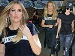 "Khloe Kardashian looks salon fresh and wears a t-shirt with the print ""I love you"" paired with hoop earrings and capri leggings as she catches a flight out of LAX with little sister Kendall Jenner. Wednesday, August 5, 2015. X17online.com"