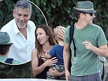 ©2015 RAMEY PHOTO 310-828-3445\nLake Como, Italy \nExclusive\nNo Web usage without agreed fee.\nGeroge Clooney helps Edward Norton and his wife ast they arrive by boat to his Italian home in Lake Como.\n080315\nWIND7