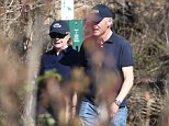**Exclusive** Hilary Clinton and Husband Bill go for a stroll holding hands in a Park in Chappaqua, New York. Hilary looked relaxed as she smiled stood next to her Secret Service agent whilst Bill, wearing Jeans and trainers ejoyed the sunshine with his Secret Service Agent as well.