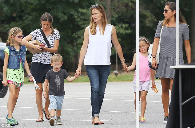 Brave face: The actress, who's filming Miracles From Heaven in Atlanta, was seen with her and Ben's children Violet, nine, Seraphina, six, and Samuel, three, on Saturday along with two female companions