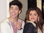13 DEC 2010 - LONDON - UK\n\nZAIN MAILK FROM BOYBAND 'ONE DIRECTION' AND GENEVA LANE FROM GIRLBAND 'BELLE AMIE' PICTURED  LEAVING THE X-FACTOR STUDIOS AFTER THE FINAL RESULTS SHOW OF THE SERIES. MATT CARDLE HAS WON THIS YEARS X-FACTOR!\n\nBYLINE MUST READ : XPOSUREPHOTOS.COM\n\n*UK CLIENTS MUST CALL PRIOR TO TV OR ONLINE USAGE PLEASE TELEPHONE 020 7377 2770 & +1 310 562 7073*