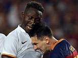 Barcelona talisman Lionel Messi (right) launched an astonishing headbutt at Roma defender Mapou Yanga-Mbiwa