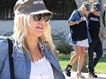Please contact X17 before any use of these exclusive photos - x17@x17agency.com   Daryl Hannah  nursing a broken foot gets some help from her boyfriend Neil Young. The 54 year old actress and that 69 year old singer were very cozy while running errands in Malibu X17online.com