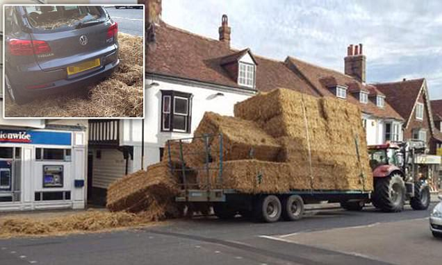 Bales of straw smash into cars after falling off a tractor's trailer in Tenterden, Kent
