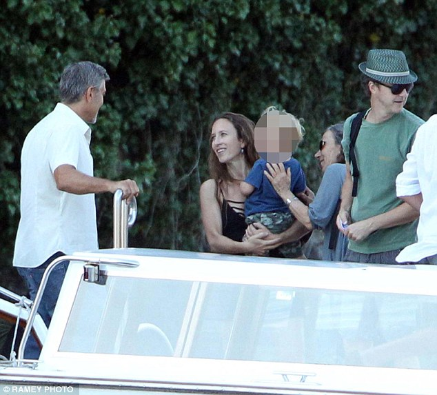 Charmer:Edward, 45, and his beautiful wife Shauna Robertson, along with their two-year-old son Atlas were greeted by the actor as they became the latest people to experience the Clooney holiday charm