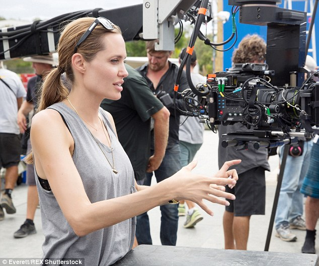 Many roles: The 40-year-old star wrote, directed and starred in By The Sea. She is pictured on the set of her last directorial Unbroken in 2014