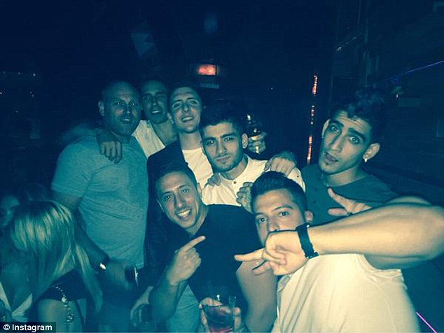 Living it up: Zayn Malik appeared to be having the time of his life on Saturday as he partied with a group of male pals at Los Angeles club Hyde, just a few days after his split from Little Mix singer Perrie Edwards