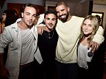 "TORONTO, ON - AUGUST 05:  Drake (3rd from L) poses with former ""Degrassi"" co-stars Daniel Clark, Adamo Ruggiero and Lauren Collins at the screening of ""We Are Disorderly"" held at the Royal Cinema on August 5, 2015 in Toronto, Canada.  (Photo by George Pimentel/WireImage)"