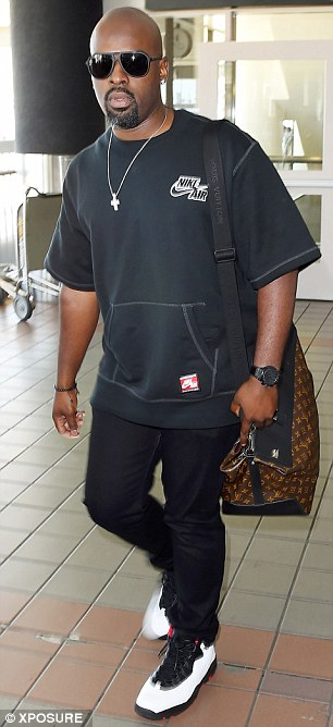 Not solo: Corey Gamble was also seen at the airport with the famous reality TV stars