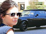 Kendall Jenner drives a vintage black Camaro SS in Beverly Hills, CA. August 4, 2015. X17online.com