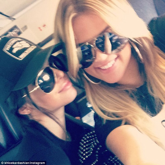 Made it! Khloe took to Instagram and posted a shot of the two girls on a plane captioned 'And we're out'