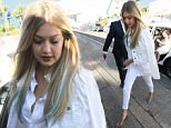 EXCLUSIVE: ***EXCLUSIVE*** Gigi Hadid visits Bondi Icebergs in a striking white ensemble to promote new Guess range.....Pictured: GIGI HADID..Ref: SPL1095076  060815   EXCLUSIVE..Picture by: madmax Pepito / Splash News....Splash News and Pictures..Los Angeles: 310-821-2666..New York: 212-619-2666..London: 870-934-2666..photodesk@splashnews.com..