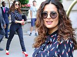Salma Hayek is all smiles wearing a lipstick shirt while heading out her hotel in NYC\n\nPictured: Salma Hayek\nRef: SPL1094864  060815  \nPicture by: Sharpshooter Images/Splash News\n\nSplash News and Pictures\nLos Angeles: 310-821-2666\nNew York: 212-619-2666\nLondon: 870-934-2666\nphotodesk@splashnews.com\n