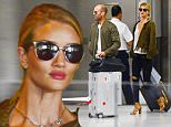 06.AUGUST.2015 - MIAMI - USA\n*EXCLUSIVE ALL ROUND PICTURES*\nPOWER COUPLE JASON STAHAM AND ROSIE HUNTINGTON-WHITELEY ARRIVE AT MIAMI INTERNTAIONAL AIRPORT. ROSIE WORE A LEOPARD PRINT JACKET WITH BLACK RIPPED JEANS AND TAN HEELS AND JASON WORE A KHAKI BOMBER JACKET WITH BLACK JEANS!\nBYLINE MUST READ : XPOSUREPHOTOS.COM\n***UK CLIENTS - PICTURES CONTAINING CHILDREN PLEASE PIXELATE FACE PRIOR TO PUBLICATION ***\n**UK CLIENTS MUST CALL PRIOR TO TV OR ONLINE USAGE PLEASE TELEPHONE 0208 344 2007**