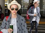 6.AUGUST.2015 - LOS ANGELES - USA\nAUSTRALIAN ACTRESS AND TATTOOED BEAUTY RUBY ROSE CARRIES A GREEN JUICE IN A JAR AS SHE ARRIVES AT LOS ANGELES INTERNATIONAL AIRPORT LAX AIRPORT WEARING A CREAM FEDORA HAT, A SKULL GREY CARDIGAN AND CARRYING A RED BACKPACK\nBYLINE MUST READ : XPOSUREPHOTOS.COM\n*AVAILABLE FOR UK SALE ONLY*\n***UK CLIENTS - PICTURES CONTAINING CHILDREN PLEASE PIXELATE FACE PRIOR TO PUBLICATION ***\n*UK CLIENTS MUST CALL PRIOR TO TV OR ONLINE USAGE PLEASE TELEPHONE 0208 344 2007*