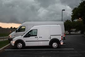 Waiting white vans designed to transport dissidents to their new residences.They have also been seen traveling through select neighborhoods ...