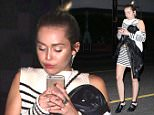 UK CLIENTS MUST CREDIT: AKM-GSI ONLY\nEXCLUSIVE: **SHOT ON 8/5/15** Santa Monica, CA - Miley Cyrus enjoyed a dinner with friends at Nobu followed by some late night fun at Shore Bar in Santa Monica.  The fashion forward pop star showed off her midriff in a white and navy blue striped crop top and matching skirt. She briefly stepped out of the bar for a smoke break and chatted it up with her pals. On her way out of Shore Bar, Miley covered her face with a black leather jacket and dashed to her ride.\n\nPictured: Miley Cyrus\nRef: SPL1096692  060815   EXCLUSIVE\nPicture by: AKM-GSI \n\n