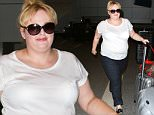 Australian comic Rebel Wilson traveled casual, arriving at LAX with a smile for her fans on Friday, August 7, 2015  X17online.com