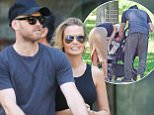 NEW YORK, NY - AUGUST 07:  Sam Worthington and Lara Bingle seen taking their baby boy Rocket for a walk on August 7, 2015 in New York City.  (Photo by Charles Bladen/GC Images)