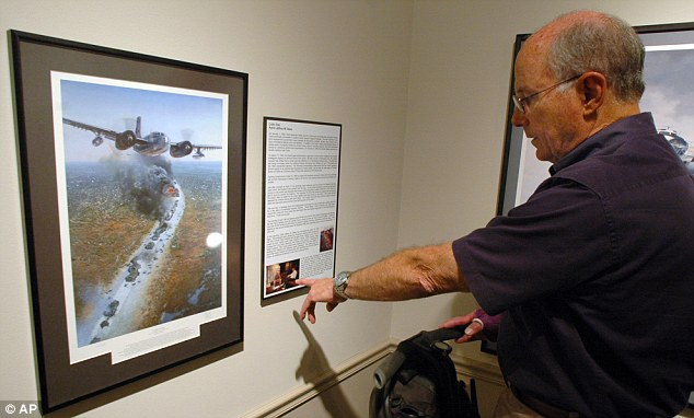 New collection:  Jim Griffin, executive director of the Southern Museum of Flight in Birmingham, Alabama viewing a new exhibit titled Shadow Gallery, The Art of Intelligence