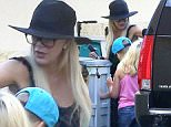 Tori Spelling takes her kids, Stella and Liam to the spa wearing a hat and glasses and taking the back door August 8, 2015  X17online.com