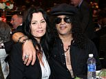 CENTURY CITY, CA - AUGUST 07:  Meegan Hodges and Slash attends the 15th annual Harold & Carole Pump Foundation gala at the Hyatt Regency Century Plaza on August 7, 2015 in Century City, California.  (Photo by Tiffany Rose/Getty Images for Harold & Carole Pump Foundation)